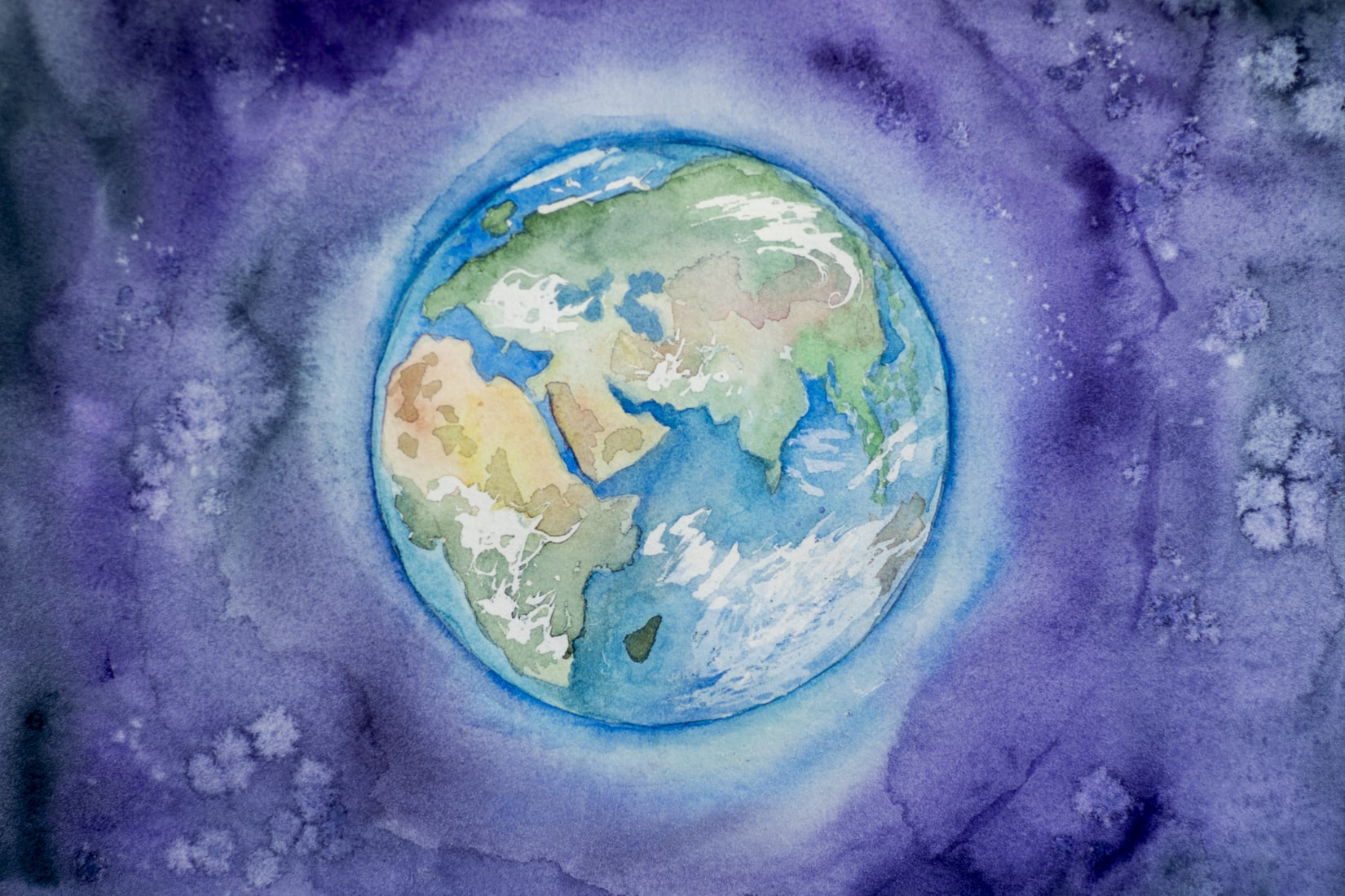 Watercolor image of the Earth by Elena Mozhvilo, Earth Day 2022